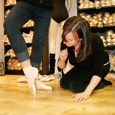 Pointe shoe fitting including assessing the fit of the shoe and its suitability at Dancers Boutique.