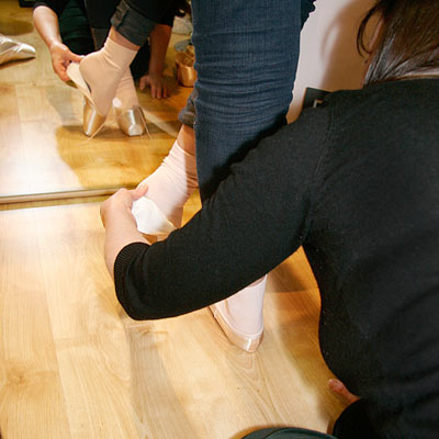 Checking the length of the fit for the pointe shoe at Dancers Boutique.
